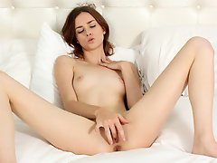Petite amateur strips off her bra and panties to massage her little...