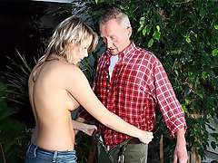 An elderly man is busy gardening but is bothered by his back. By...