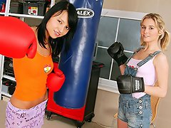 Two teenage girls are having a little boxing game. They take off...