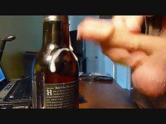 Ejaculating onto a beer bottle