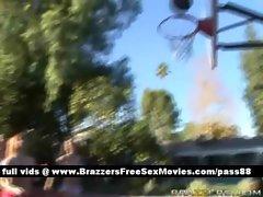 Three amateur chicks outside playing basketball