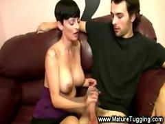 Sexy topless MILF tugs a hard cock