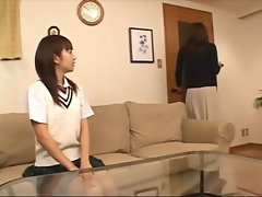 Asian Schoolgirl Sucking Busty Woman Nipples Kissing On The Couch In The Sitting Room
