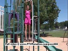 Lovely naked brunette in a public park