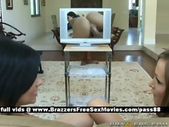 Two horny babes at home looking at a porn movie get excited