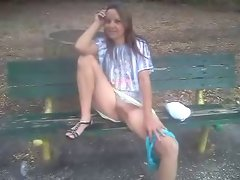 Flashing sexy fanny on a park bench