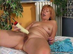 Redhead granny with brutal nipples masturbates
