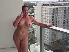 Slutty girl nude flashing on balcony
