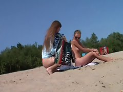 Naked luscious teen nudist lets the water kiss her body