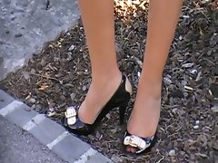 sensual legs with peep toe heels on the walk