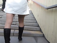 Girlie in stockings going upstair
