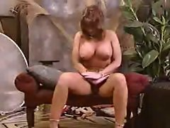 Top heavy Mum with genetal and nipple piercings posing on camer