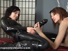 Role playing lesbos fuck with a huge strapon rubber toy