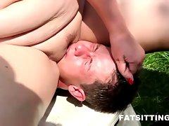 Fatty domme Monika facesitting her bony male slave