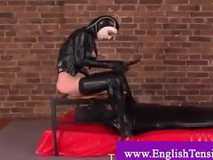 Masked dominatrix facesits restrained slave