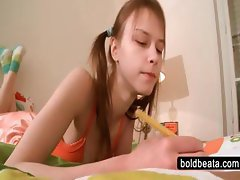 Delicate teen playing in bed