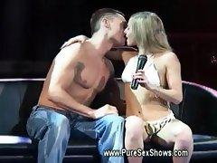 Horny couple show the crowd how to eat pussy properly