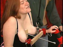 Fat corseted redhead with huge cunt lips gets her tits clamped hard and rough