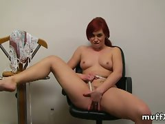 Redhead feliciia filmed getting naked and fingering