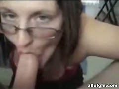 Bitch with glasses sucking boyfriend's cock