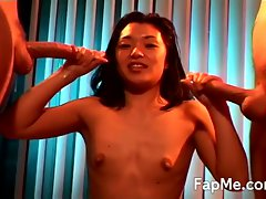 Cute asian girl jacks off two cocks