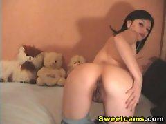 Sweet brunette babe masturbating on webcam in solo scene