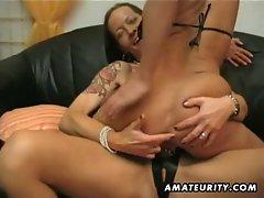 Pierced pussy slut fucking strap on