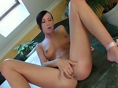Sassy brunette drills her pussy with red dildo