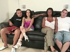 Interracial foursome sit on the couch and talk
