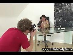 Mature lingerie slut poses for photographer