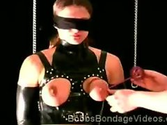 Nasty whore is tied up during bondage torture session