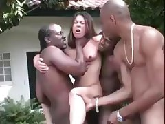 Brunette Ashley gets three big black cocks outside and gets hammered