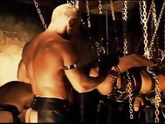 4 way CBT session where the bottom is suspended from chains while his balls are squeezed hard.