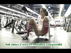 Trinity sexy brunette teen fingering pussy and flashing tits at the gym
