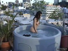 Crissy Moran fingers her sweet pussy in the jacuzzi