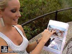 Sexy and beautiful Vega Vixen showing her photo album and enjoying it
