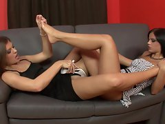 Black Angelica and Hannah Hunter enjoying hot lesbian fun on the couch