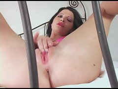 Latina whore Rebecca Linares fucks her wet pussy on her cum covered bed