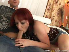 Lusty Kylie Ireland sucks a huge meaty shaft in her mouth