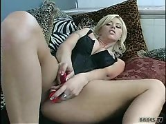 Buxom babe Britney Skye masturbating solo with her toys