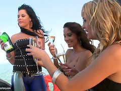 Blue Angel getting sexy on a glass of wine on a yacht with her girlfriends