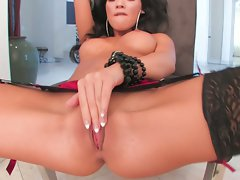 Sexy and horny Asa Akira rubs her slit until she cums