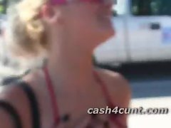 Bikini babe shakes her bare ass for a handful of cash