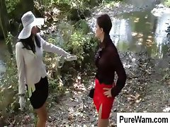 Dressed in fancy clothing a couple of lesbian bitches get dirty in the mud