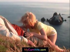 Blonde wife is outside by the ocean and gives him a cum filled blowjob