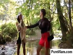 Two hot lesbians are out at a little creek and playing in the mud