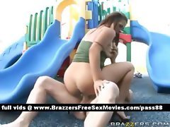 Busty blonde slut outside in a children park