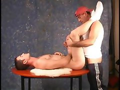 Dude in a baseball cap pounds his boyfriends tight ass on the table