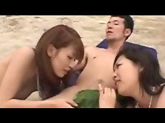 Horny asians have sandy fun on beach