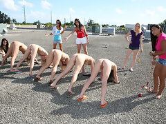 Group of sexy girls are being hazed on a roof in the sun and naked